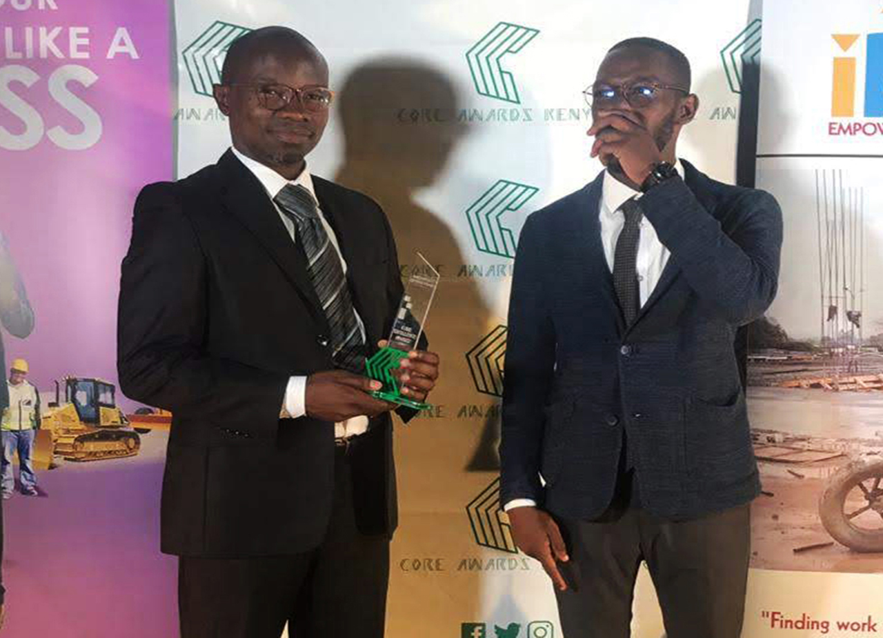 Anthony Opil, Senior Architect with the CORE trophy for Architecture Firm of the Year and Mark Mwoka, Candidate Architect.